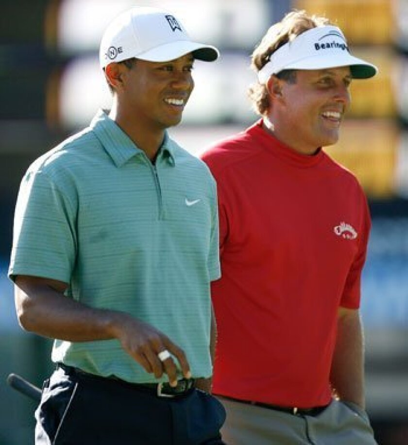 In the pairings released by the U.S. Golf Association, world No. 1 Tiger Woods and No. 2 Phil Mickelson, shown this 2007 file photo, were grouped together.
