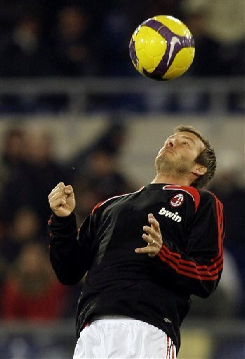 AC Milan soccer star David Beckham, of Britain, controls the ball prior to the start of the Serie A soccer match between AS Roma and AC Milan, at the Olympic stadium in Rome, Italy, Sunday, Jan. 11, 2009 (AP Photo/Andrew Medichini)