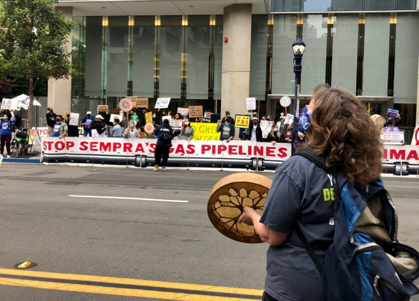 About 100 environmentalists protest in front of the corporate headquarters of Sempra Energy.