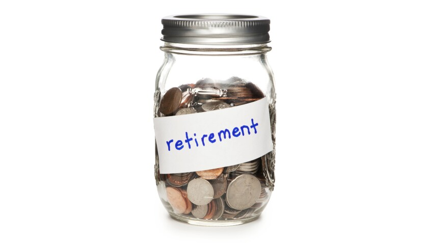 Jar of Coins Labeled Retirement on White ORG XMIT: CHI1406251238495260