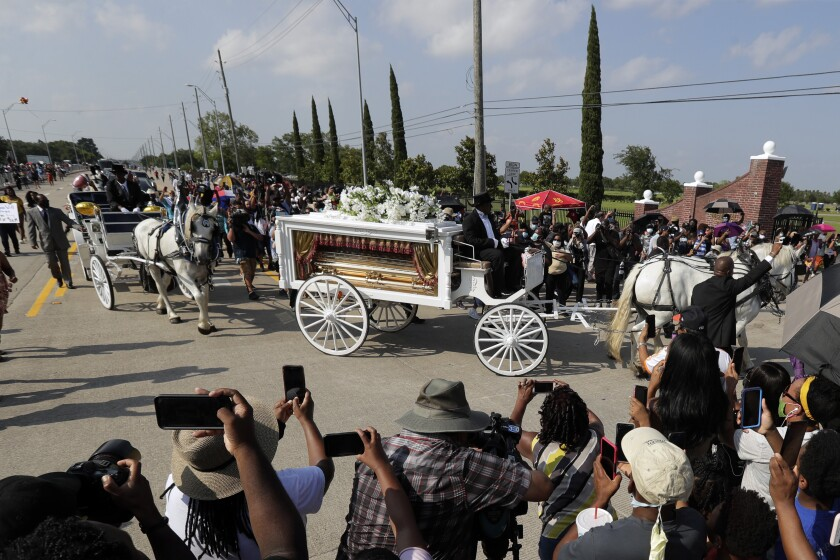 George Floyd's funeral procession arrives at Houston Memorial Gardens cemetery.