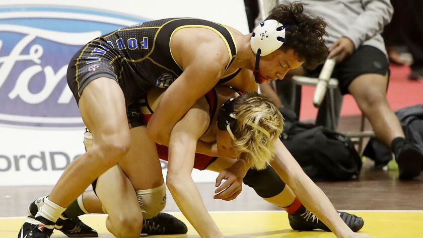 Fountain Valley High freshman Max Wilner, left, competes in a 145-pound match during the first day o