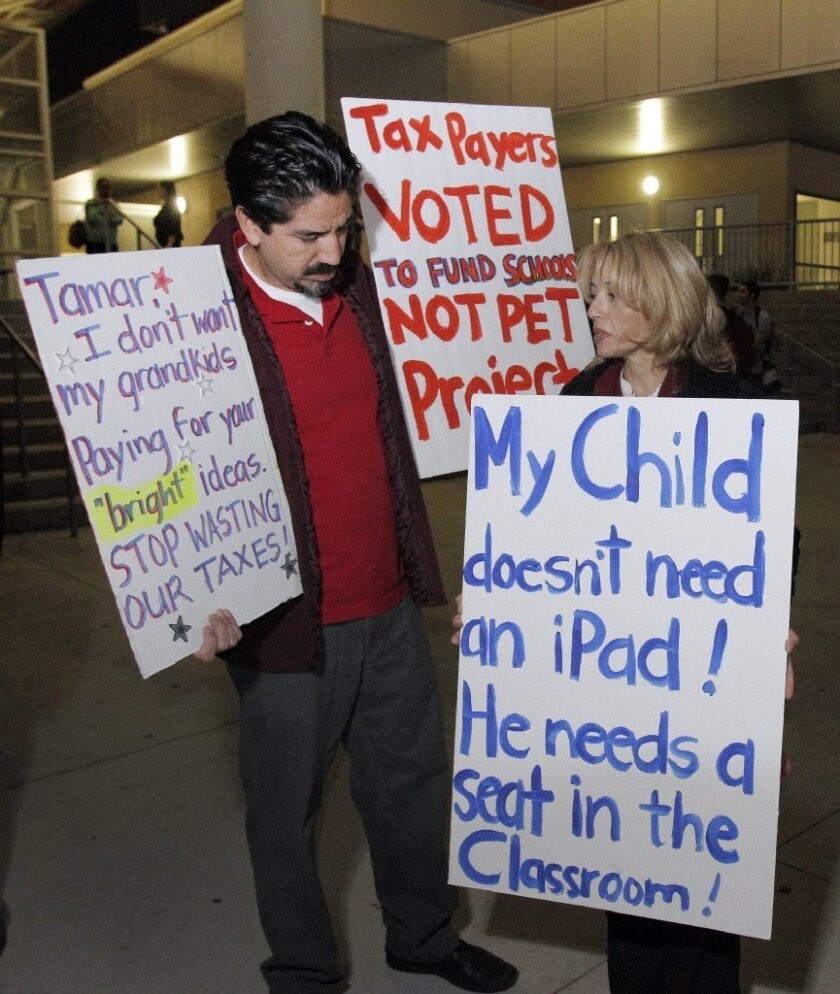 A November 2013 protest in Granada Hills against L.A. Unified's purchase of iPads for students.