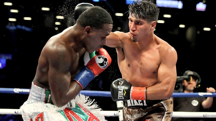 Mikey Garcia and Adrien Broner exchange punches during their junior-welterwight bout on Saturday night at Barclays Center.