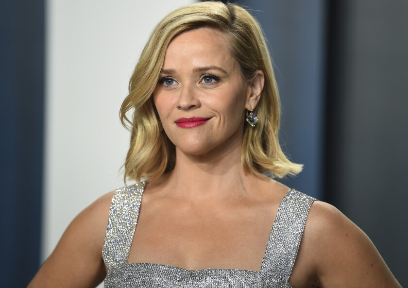 Reese Witherspoon in a silver dress.