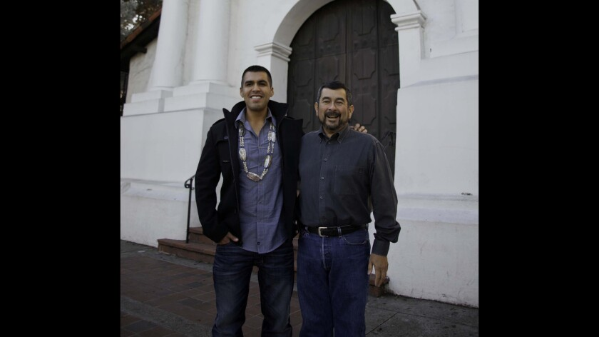 Andrew Galvan, right, is curator at the Mission Dolores in San Francisco. His cousin Vincent Medina, left, leads tours at the same mission. Both have ancestral connections to Ohlone neophytes who were baptized and buried at the mission more than 200 years ago.