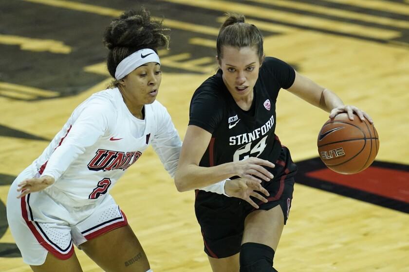 Stanford's Lacie Hull (24) drives around UNLV's Jasmine Singleton (2) during the second half of an NCAA college basketball game Saturday, Dec. 5, 2020, in Las Vegas. (AP Photo/John Locher)