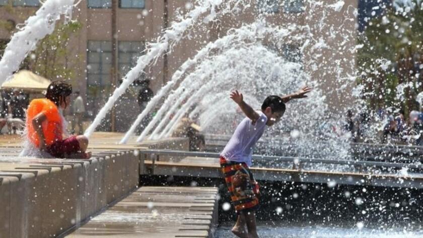 Children play in water.