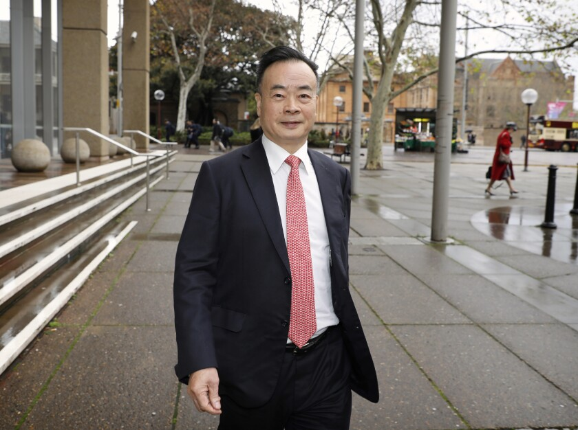 Chau Chak Wing leaves the Federal Court in Sydney, June 19, 2018. Chinese-Australian billionaire Chau Chak Wing was awarded 590,000 Australian dollars ($450,000) in damages on Tuesday, Feb. 2, 2021, after winning his defamation case over an a state broadcaster's investigation that suggested he was a member of the Chinese Communist Party who bribed Australia lawmakers to make decisions in China's interests. (Chris Pavlich/AAP Image via AP)