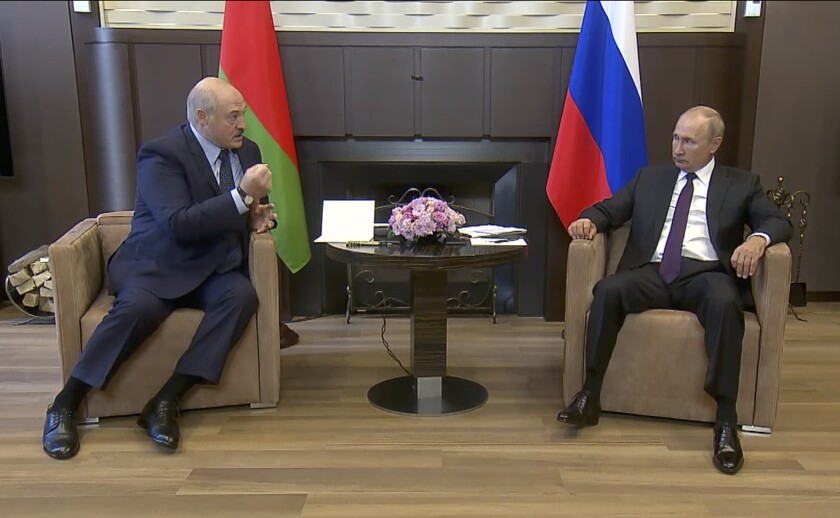 Russian President Vladimir Putin, right, and Belarusian President Alexander Lukashenko meet in Sochi, Russia.