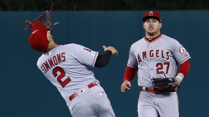 Los Angeles Angels shortstop Andrelton Simmons (2) catches a fly ball by Detroit Tigers' Jeimer Cand