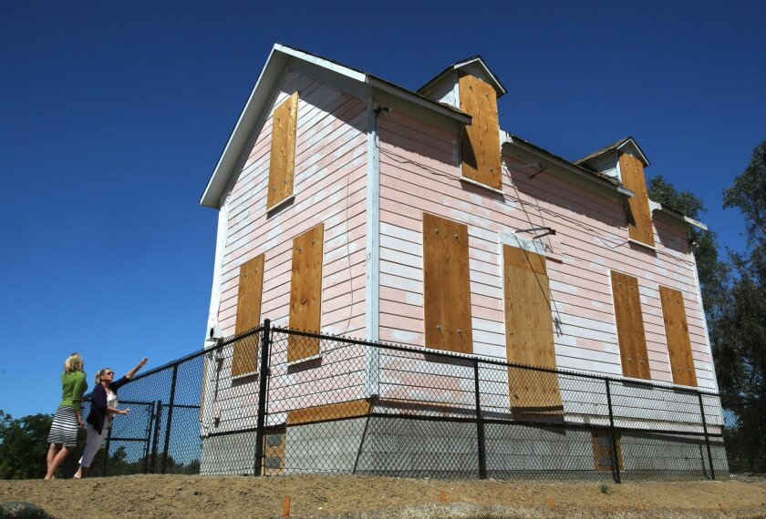 Old pink house in San Marcos finds new home down Discovery Street