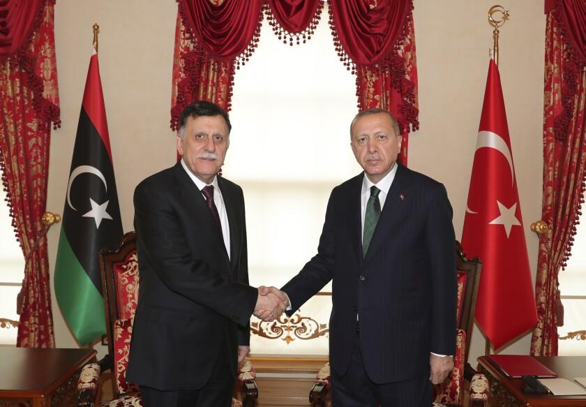 CORRECTION Libya Who's Who