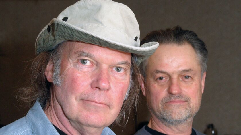 Musician Neil Young, left, and director Jonathan Demme, posing in Austin, Texas, at the South by Sou