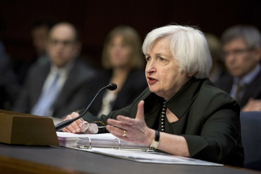 Federal Reserve Chairwoman Janet Yellen testifies at a congressional Joint Economic Committee hearing in Washington on Thursday. Employers added more jobs than forecast in November, underscoring Yellen's confidence that the U.S. economy is strong enough to withstand higher borrowing costs.