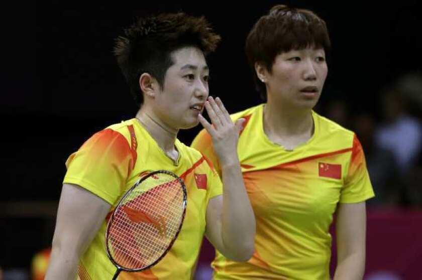 China's Yu Yang, left, and Wang Xiaoli in a women's doubles badminton match.