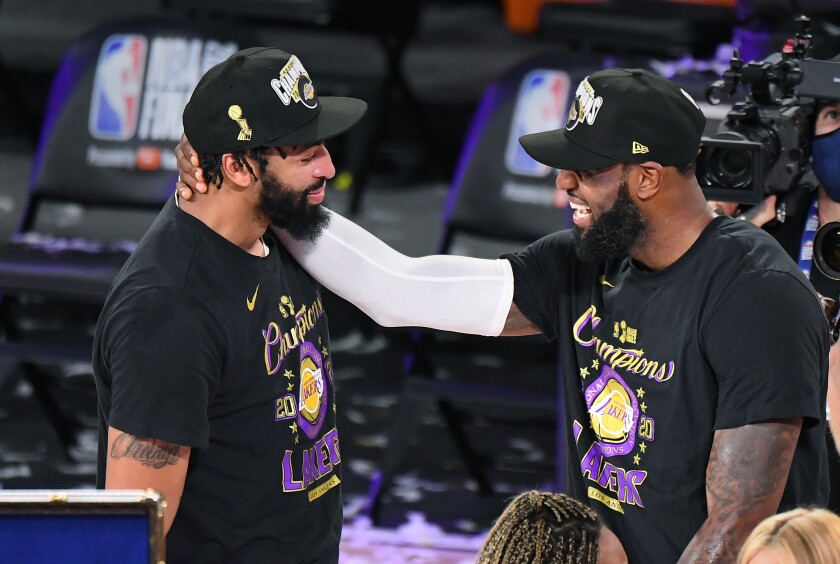 Anthony Davis and LeBron James celebrate after defeating the Heat on Oct. 11, 2020, to win the NBA title.