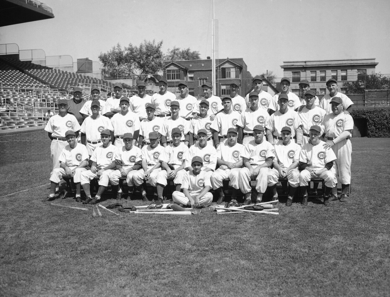 Members of the Chicago Cubs pose for the 1945 team picture in Wrigley Field, Chicago, Aug. 27, 1945. Front row, left to right: Stan Hack, Don Johnson, Harry Lowrey, Phil Cavarretta, Andy Pafko, manager Charley Grimm, Bill Nicholson, Paul Gillespie, Len Merullo, Hank Borowy. Second row, left to right: Claude Passeau, Mickey Livingston, Paul Derringer, Len Rice, Dewey Williams, Ray Prim, Bob Chipman, Hy Vandenberg, Frank Cory, Heinz Becker, coach Red Smith. Back row, left to right: trainer Andy Lotshaw: Hank Wyse, Lon Warneke, Ray Starr, Paul Erickson, Ed Hanyzewski, Roy Johnson, Walter Signer, Ed Sauer, Roy Hughes, Bill Schuss, coach Milt Stock. Batboy is Jim Chalikis. (AP Photo)