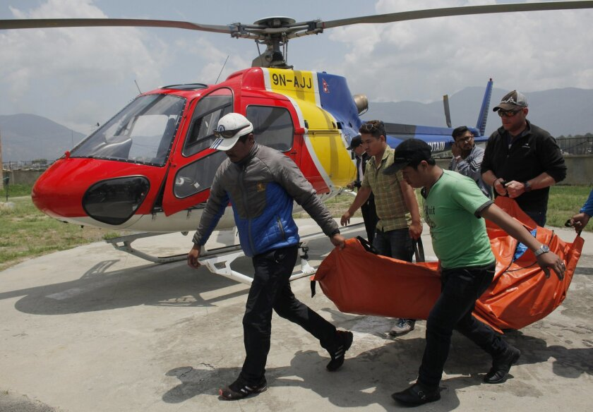 The body of Dutch climber Eric Arnold, who died last week near South Col during a Mount Everest expedition, is carried to Teaching hospital in Kathmandu, Nepal, Thursday, May 26, 2016. This year's busy climbing season follows two years of disasters that virtually emptied the mountain. (AP Photo/Nir