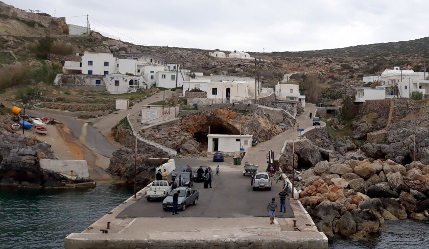 When the ferry docks at the port of Antikythera, everyone comes down to the dock, some to pick up de