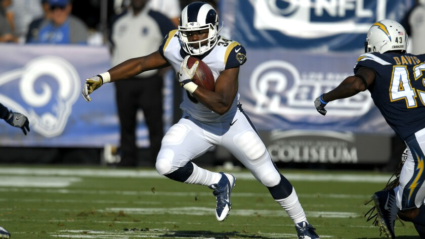 Los Angeles Rams running back Malcolm Brown runs with the ball during the first half of a preseason