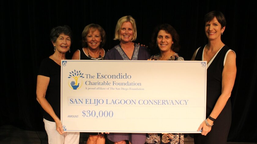 Escondido Charitable Foundation grants chairperson Ruth Tsoulos, far left, presents a grant check to the San Elijo lagoon Conservancy. Next to her from left are foundation member Rita Bowcock, San Elijo Lagoon Conservancy staff Jennifer Bright and Tara Fuad and Escondido Charitable Foundation foun