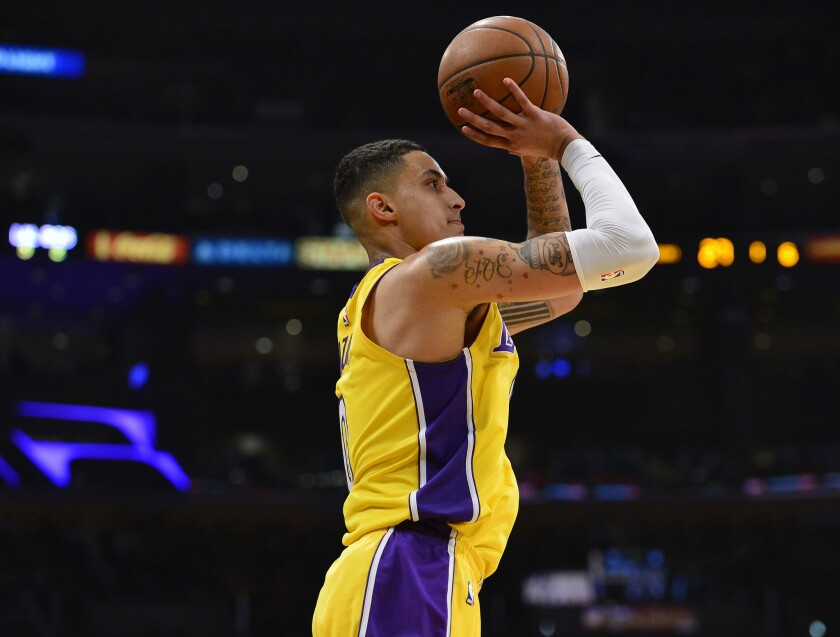 January 23, 2018; Los Angeles, CA, USA; Los Angeles Lakers forward Kyle Kuzma (0) shoots against the Boston Celtics during the first half at Staples Center.