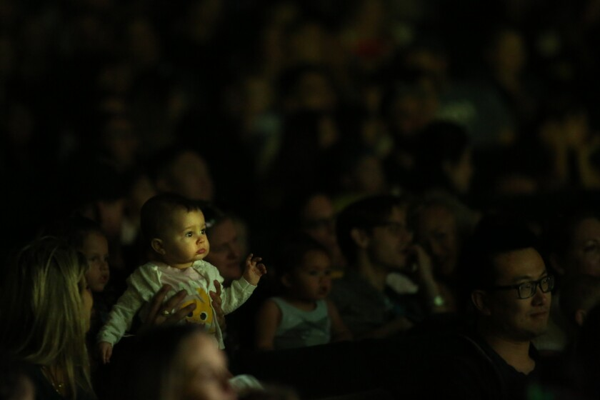 "A baby watches ""Baby Shark Live!"" in Long Beach"
