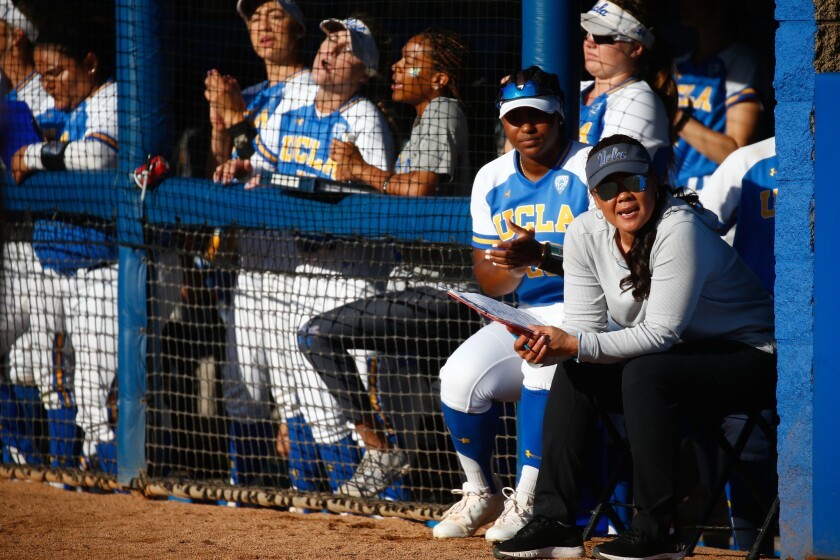 UCLA softball coach Kelly Inouye-­Perez, right, is shown during an NCAA Super Regional game on May 25, 2019.