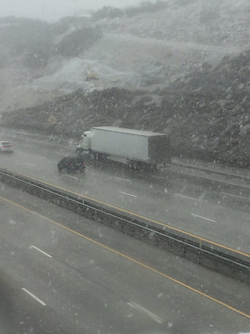 Snow began falling Monday afternoon in the Tejon Pass.