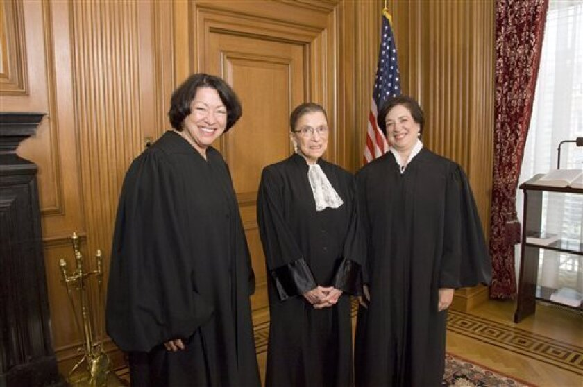 This handout photo provided by the Supreme Court shows, from left, Justices Sonia Sotomayor, Ruth Bader Ginsburg, and Justice Elena Kagan in the Justices' Conference Room prior to Justice Kagan's Investiture Ceremony, Friday, Oct. 1, 2010, at the court in Washington. (AP Photo/Steve Petteway, Supreme Court)
