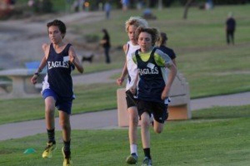 Finn Waters, right, won the boys South Coast Middle School League Championships in cross country. The RSF boys team took second overall. Courtesy photo