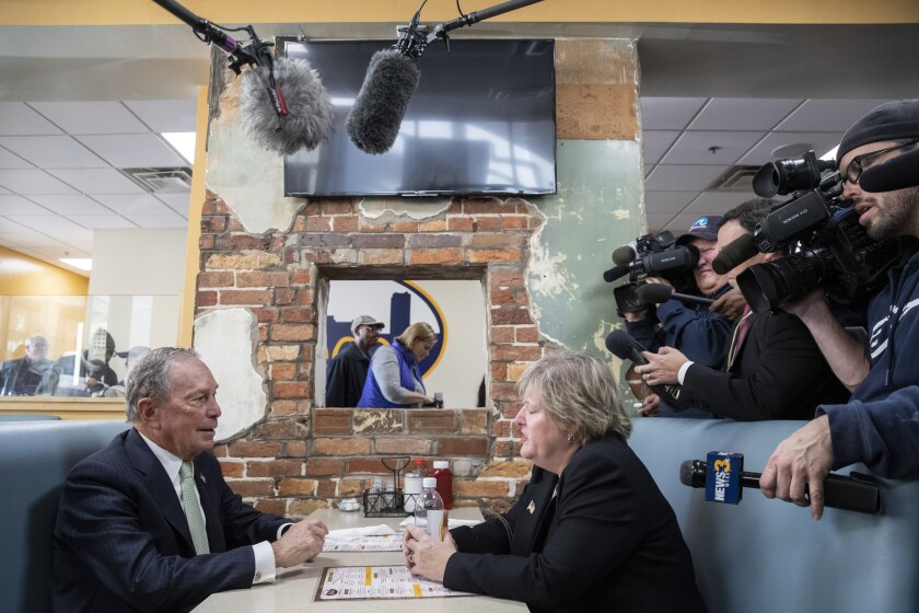 Democratic presidential candidate Mike Bloomberg meets with Nancy Guy