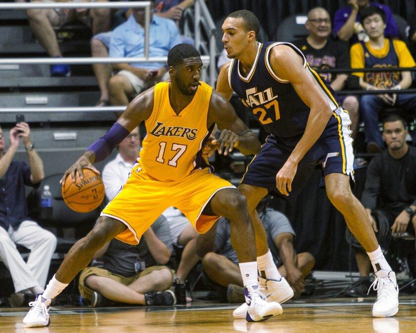 Utah Jazz center Rudy Gobert (27) defends Los Angeles Lakers center Roy Hibbert (17) during the third quarter of a preseason NBA basketball game in Honolulu.