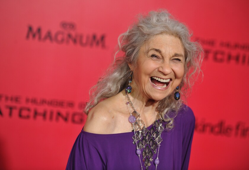 """FILE - In this Nov. 18, 2013 file photo, Lynn Cohen arrives at the Los Angeles premiere of """"The Hunger Games: Catching Fire"""" at Nokia Theatre LA Live. Cohen, an actress best known for playing the plainspoken housekeeper and nanny Magda in """"Sex and the City,"""" has died. She was 86. Cohen died Friday, Feb. 14, 2020 in New York City, said her manager, Josh Pultz. (Photo by Jordan Strauss/Invision/AP)"""