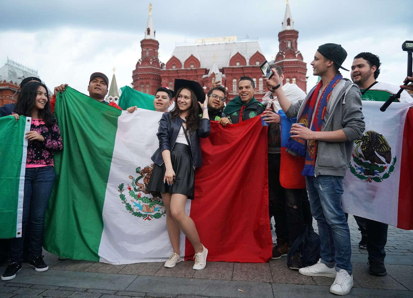 MOSCOW, RUSSIA - JUNE 11: Football fans from Russia and Mexico pose for selfies together near Red Square ahead of the World Cup on June 11, 2018 in Moscow, Russia. Moscow and Russia is gearing up for the start of the World Cup tournament. FIFA expects more than three billion viewers for the World Cup that begins this week in Russia. (Photo by Christopher Furlong/Getty Images) ** OUTS - ELSENT, FPG, CM - OUTS * NM, PH, VA if sourced by CT, LA or MoD **
