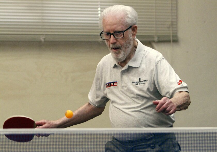 Si Wasserman, 90, returns a shot while playing table tennis with fellow Rancho Carlsbad residents on Friday. Wasserman, who has been playing in tournaments since 1949, recently won a gold medal in the World Senior Games in St. George, Utah, in the 90 and above age category. He was inducted into the United States of America Table Tennis Hall of Fame in 2006. Don Boomer • U-T