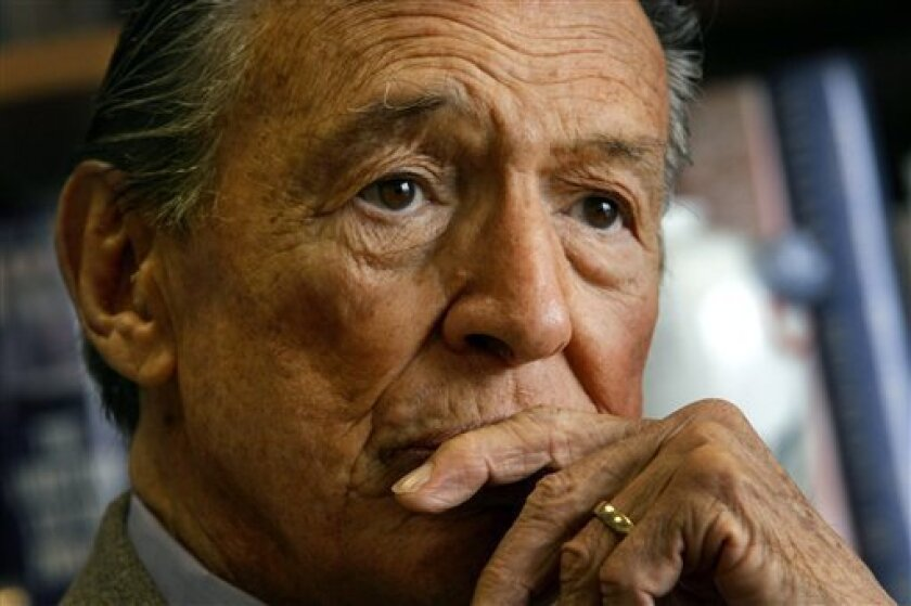 "FILE - This May 8, 2006 file photo shows Mike Wallace, longtime CBS ""60 Minutes"" correspondent, during an interview at his office in New York. Wallace, famed for his tough interviews on ""60 Minutes,"" has died, Saturday, April 7, 2012. He was 93. (AP Photo/Bebeto Matthews)"