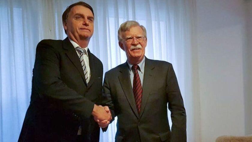 U.S. national security advisor John Bolton meets with Brazilian President-elect Jair Bolsonaro at the latter's home in Rio de Janeiro.
