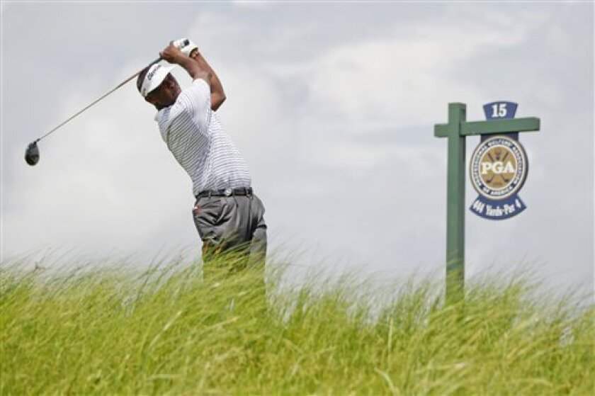 Vijay Singh of Fiji watches his drive from the 15th tee during the second round of the PGA Championship golf tournament on the Ocean Course of the Kiawah Island Golf Resort in Kiawah Island, S.C., Friday, Aug. 10, 2012. (AP Photo/Evan Vucci)