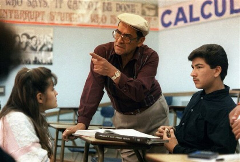 "FILE - This March 16, 1988 file photo shows Jaime Escalante, center, teaching math at Garfield High School, in Los Angeles. Escalante is the teacher on which the character in the movie ""Stand and Deliver"" is based. Escalante died Tuesday March 30, 2010. he was 79.  (AP Photo, File)"