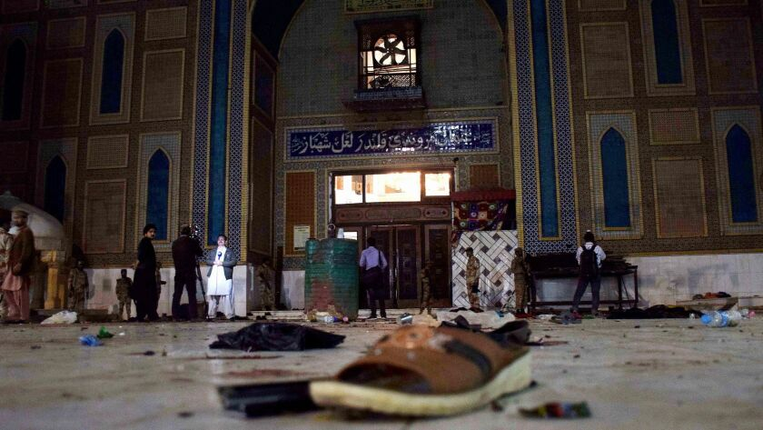 Pakistani soldiers cordon off the shrine of 13th century Muslim Sufi Saint Lal Shahbaz Qalandar after a bomb blew up in the town of Sehwan in Sindh province on Feb. 16, 2017.