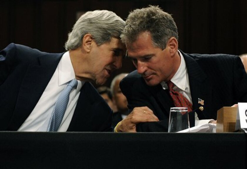 Sen. John Kerry, D-Mass., left, leans over to talk to Sen. Scott Brown, R-Mass, on Capitol Hill in Washington, Monday, June 28, 2010. prior to their introduction statements on behalf of Supreme Court nominee Elena Kagan during her confirmation hearing before the Senate Judiciary Committee. (AP Photo/Susan Walsh)