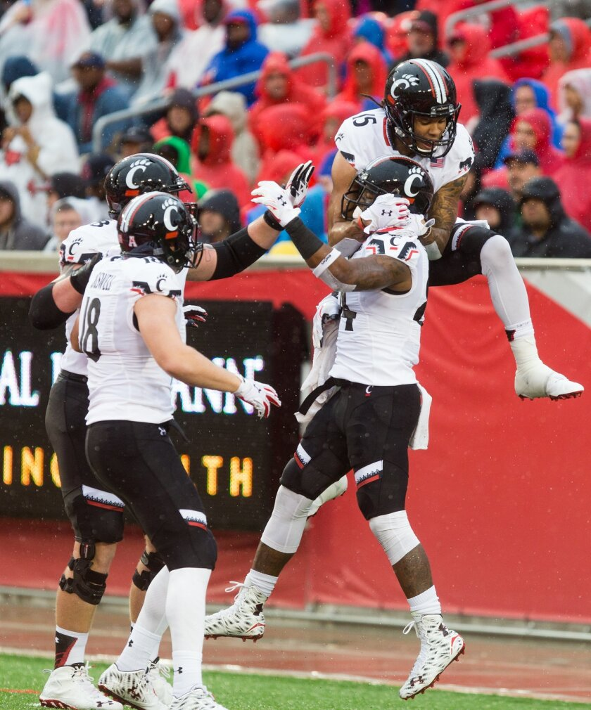 Cincinnati teammates celebrate in the end zone after scoring a touchdown during the first half of an NCAA college football game against Houston at TDECU Stadium, Saturday, Nov. 7, 2015, in Houston. (AP Photo/Juan DeLeon)