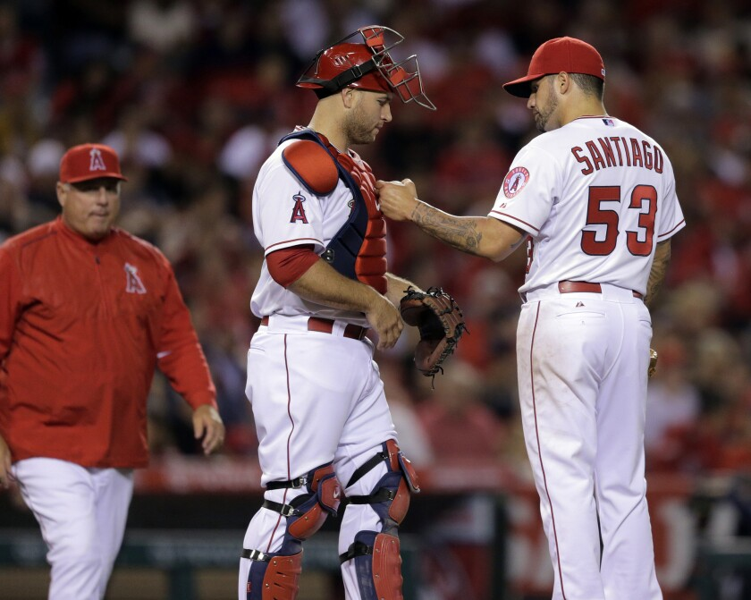 Angels Manager Mike Scioscia approaches the mound