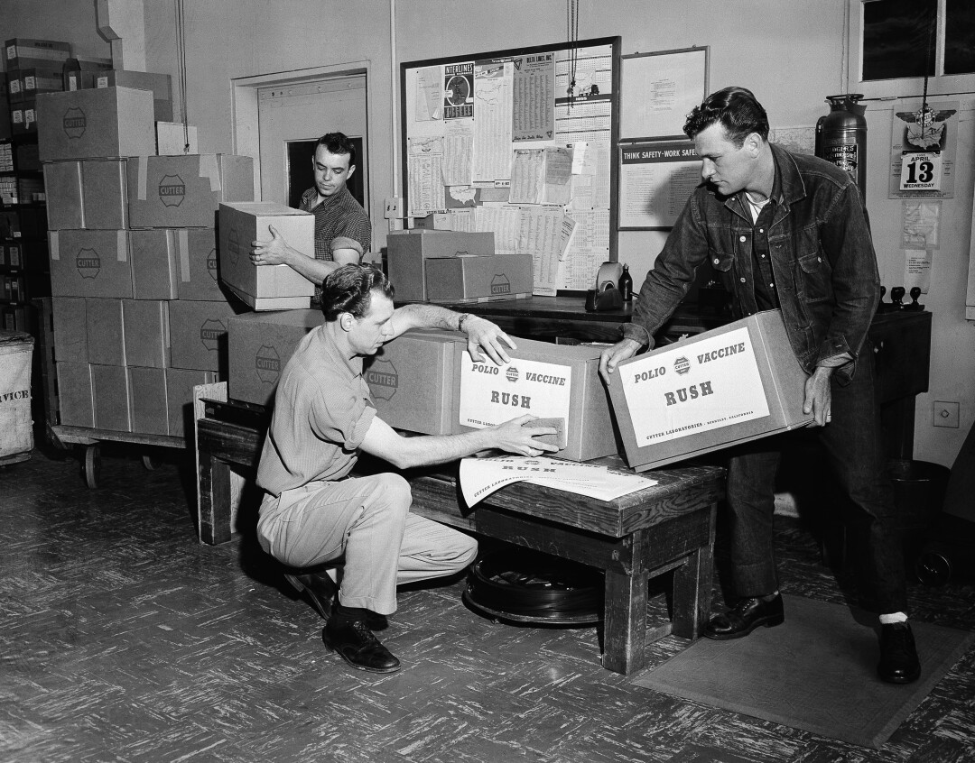 At Cutter Laboratories in Berkeley, Calif., workmen label the priority packages of Salk polio vaccine.
