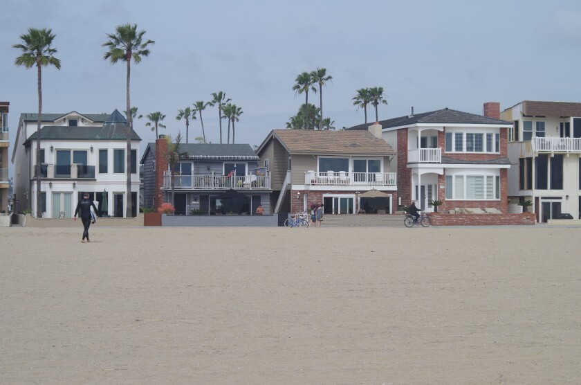 Short-term rentals are especially prevalent on the Balboa Peninsula in Newport Beach, with many facing the oceanside boardwalk shown here.