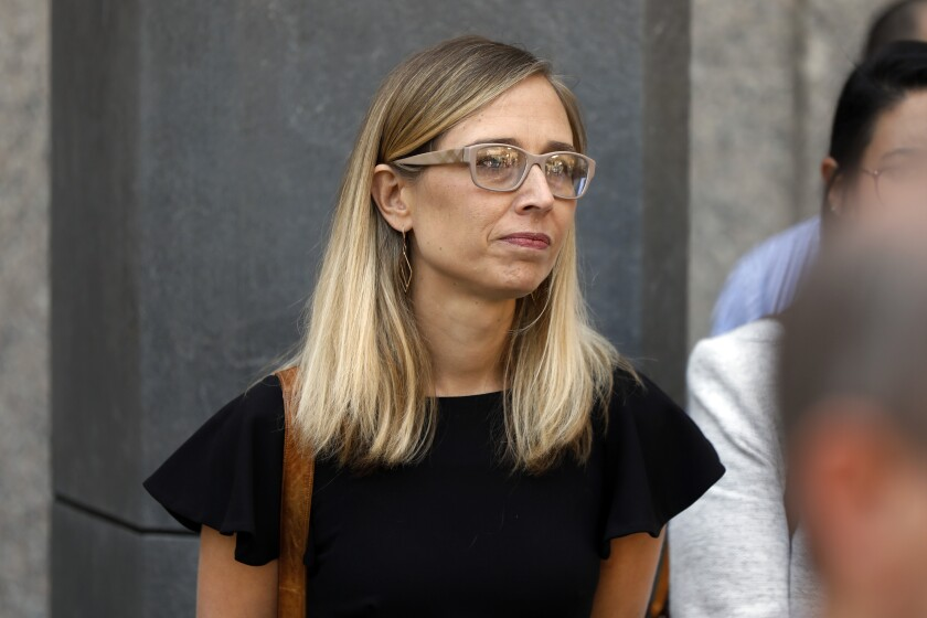 FILE - In this July 15, 2019 file photo, Annie Farmer, one of Jeffrey Epstein's accusers who spoke at his bail hearing, attends a news conference outside federal court in New York. Farmer is among three women who are suing Epstein's estate. Farmer filed a lawsuit Tuesday, Nov. 12, 2019, in Manhattan federal court. The lawsuit said Epstein touched her inappropriately after climbing into bed with her when she was 16. It said the attack occurred after Epstein flew her to his ranch in New Mexico in 1996.. (AP Photo/Richard Drew, File)
