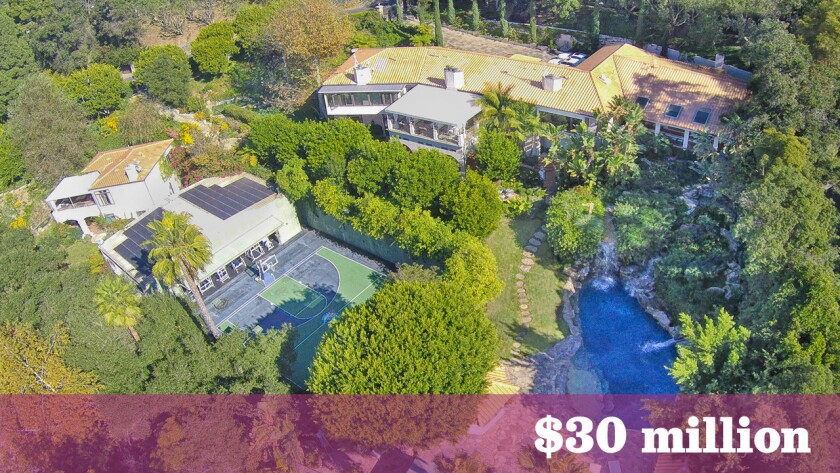 The onetime Beverly Crest-area compound of actor Mark Wahlberg has listed for sale at $30 million, up about $17 million from what the actor sold it for in 2013.