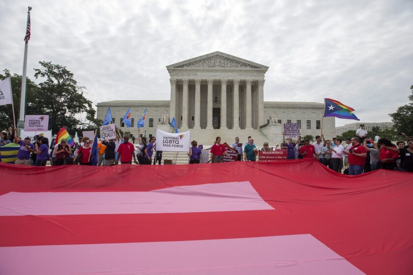 Supporters of same-sex marriage unfurl a so-called equality flag outside the Supreme Court on Friday, where the Supreme Court clears the way for same-sex marriage nationwide.